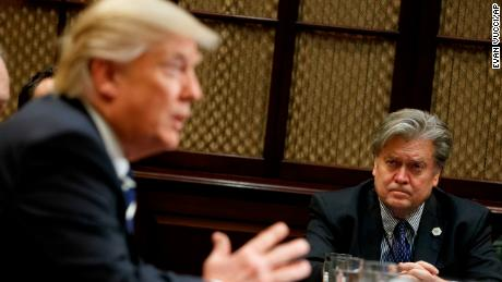 White House Chief Strategist Steve Bannon listens at right as President Donald Trump speaks during a meeting on cyber security in the Roosevelt Room of the White House in Washington, Tuesday, January 31, 2017.
