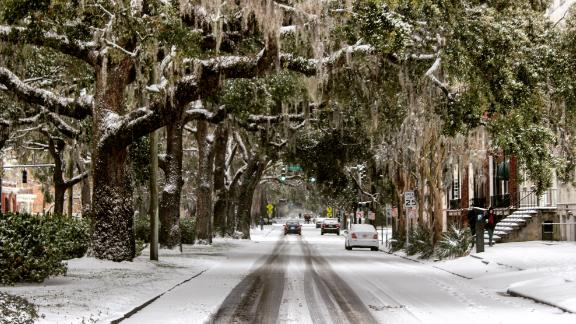A light layer of snow dusts oak trees and Spanish moss in Savannah, Georgia, on January 3.