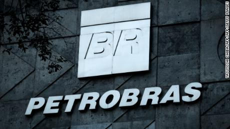 A logo of Brazilian oil company Petrobras is seen at the entrance of its headquarters in Rio de Janeiro, Brazil, on July 15, 2016. / AFP / YASUYOSHI CHIBA        (Photo credit should read YASUYOSHI CHIBA/AFP/Getty Images)