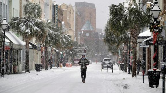A rare snowfall leaves a street virtually deserted in downtown Charleston, South Carolina, on Wednesday, January 3.