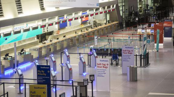 A check-in area stands empty at Boston