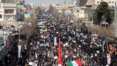 Iranian pro-government supporters march in the city of Mashhad on Thursday.