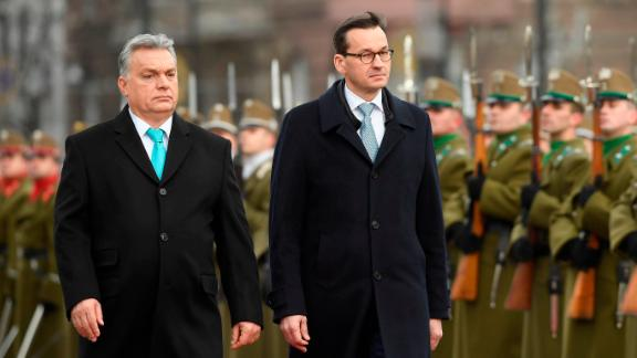 Staying on an official visit in Hungary new Polish Prime Minister Mateusz Morawiecki, right, and his Hungarian counterpart Viktor Orban inspect the honour guards during the welcoming ceremony in front of the parliament building in Budapest, Hungary, Wednesday, Jan. 3, 2018. (Tamas Kovacs/MTI via AP)