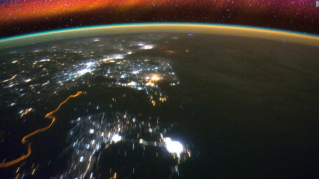 Bright swaths of red in the upper atmosphere, known as airglow, can be seen in this image taken from the International Space Station. NASA's ICON mission, with a potential launch in 2018, will observe how interactions between terrestrial weather and a layer of charged particles called the ionosphere create the colorful glow.