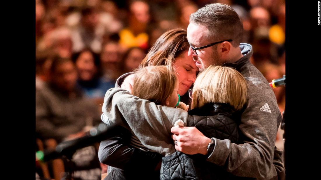 "Gracie Parrish, back left, is embraced by loved ones as she attends <a href=""http://www.cnn.com/2018/01/02/us/colorado-slain-deputy-remembered/index.html"" target=""_blank"">a candlelight vigil</a> for her late husband, Zackari, on Monday, January 1. Zackari Parrish, a 29-year-old sheriff's deputy, was fatally shot by Matthew Riehl, who opened fire on Parrish and other deputies responding to a call at Riehl's apartment in Highlands Ranch, Colorado. Riehl was killed in a shootout with police."