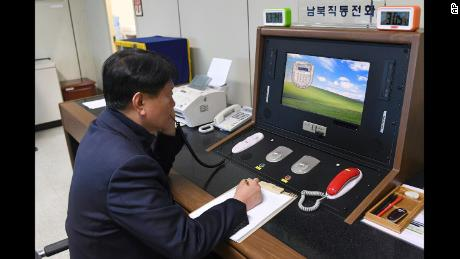 ADDS SOURCE - A South Korean government official communicates with a North Korean officer during a phone call on the dedicated communications hotline at the border village of Panmunjom in Paju, South Korea, Wednesday, Jan. 3, 2018. North Korean leader Kim Jong Un reopened a key cross-border communication channel with South Korea on Wednesday, another sign easing animosity between the rivals even as Kim traded combative threats of nuclear war with President Donald Trump. (South Korea Unification Ministry/Yonhap via AP)