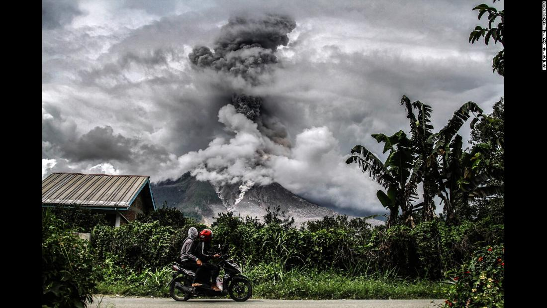Mount Sinabung spews thick smoke in Karo, Indonesia, on Tuesday, January 2. The volcano has been highly active since roaring back to life in 2010.