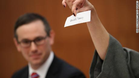 A slip of paper with the name of Virginia House of Delegates candidate David Yancey (R-VA) is shown during a meeting of the Virginia State Board of Elections January 4, 2018 in Richmond, Virginia.