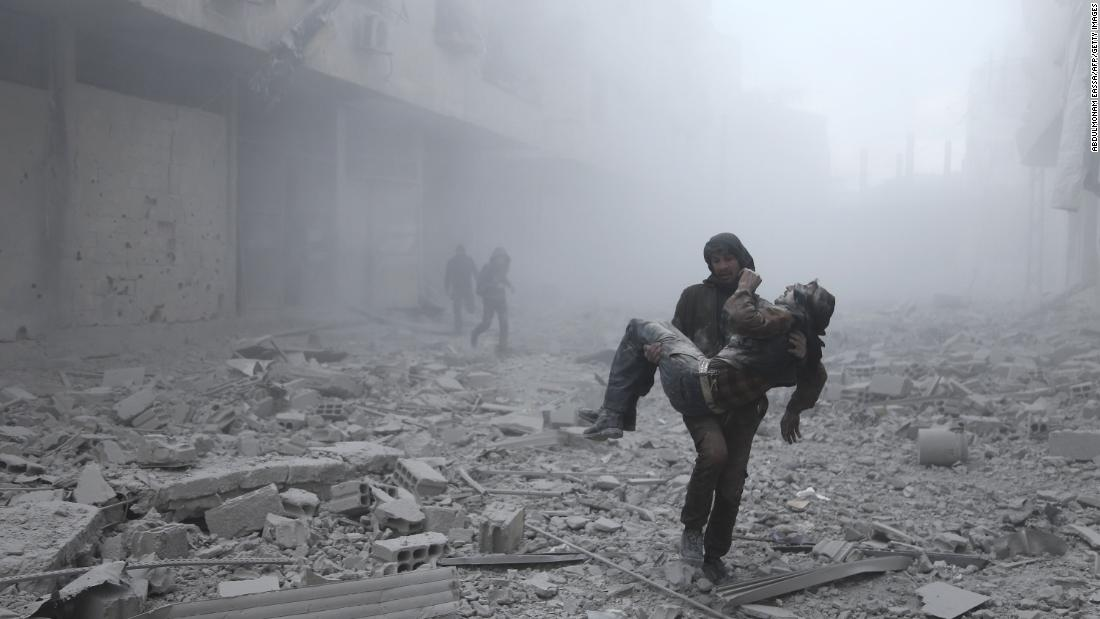 A wounded man is carried away after an airstrike on the rebel-held town of Arbin, Syria, on Tuesday, January 2. Syria's civil war has been going on since 2011.