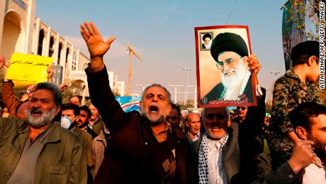 Government supporters  march following prayers Friday in Tehran.