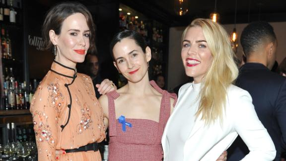 (From left) Sarah Paulson, stylist Karla Welch, and Busy Philipps at the Power Stylists Dinner, hosted by The Hollywood Reporter and Jimmy Choo, on March 14, 2017 in West Hollywood, California.