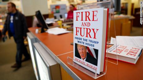 "Shoppers pass the last remaining copies of the book ""Fire and Fury: Inside the Trump White House"" by Michael Wolff at a Barnes & Noble store, Friday, Jan. 5, 2018, in Newport, Ky. (AP Photo/John Minchillo)"