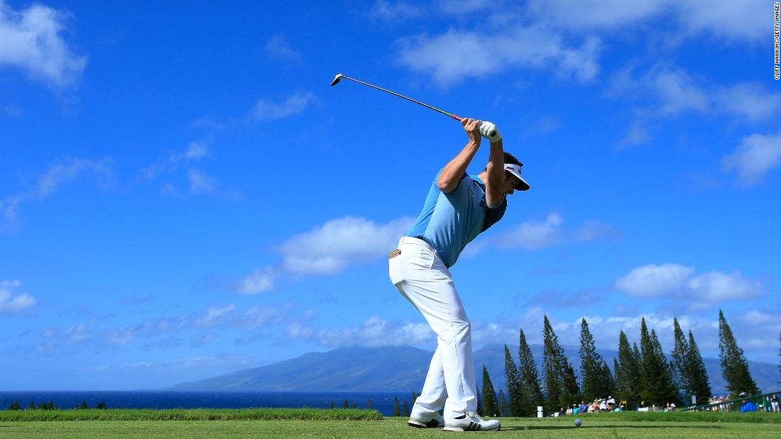 <strong>New Year's heave:</strong> Golf in 2018 teed off in Hawaii where the views are always spectacular. Jon Rahm of Spain is poised to launch one into the blue.