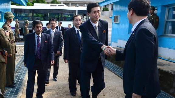 North Korean officials cross the military demarcation line (MLD) for a meeting with their South Korean counterparts on the demilitarized zone in 2013.