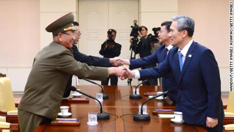 North and South Korean negotiators shake hands during high-level talks at the demilitarized zone in August 2015.