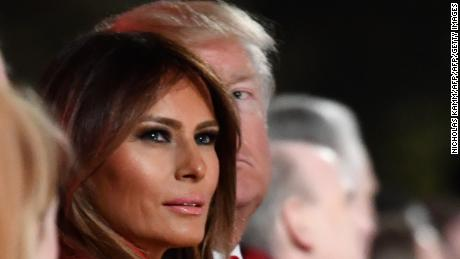 US President Donald Trump and First Lady Melania Trump look on during the 95th annual National Christmas Tree Lighting ceremony at the Ellipse in President's Park near the White House in Washington, DC on November 30, 2017. / AFP PHOTO / Nicholas Kamm        (Photo credit should read NICHOLAS KAMM/AFP/Getty Images)