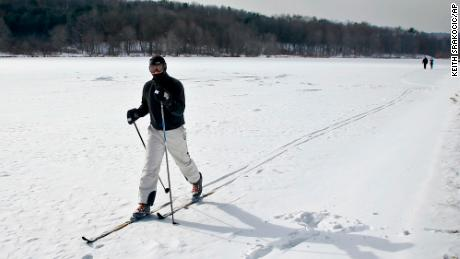 John Delcamp cross country skis along the edge of frozen Lake Arthur  in Portersville, Pennsylvania.