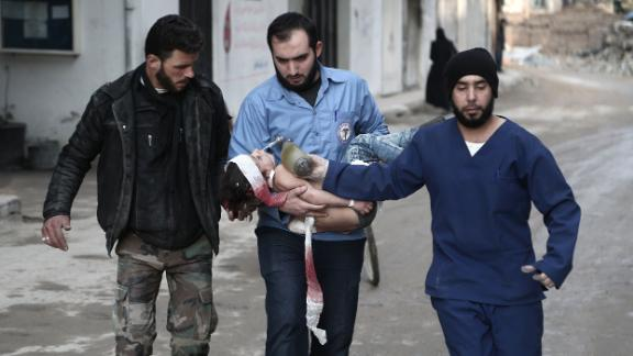 White Helmets volunteer rescuers carry a girl who was pulled from the rubble in Eastern Ghouta on January 6.