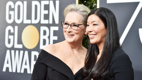 BEVERLY HILLS, CA - JANUARY 07:  Actor Meryl Streep (L) and NDWA Director Ai-jen Poo attend The 75th Annual Golden Globe Awards at The Beverly Hilton Hotel on January 7, 2018 in Beverly Hills, California.  (Photo by Frazer Harrison/Getty Images)