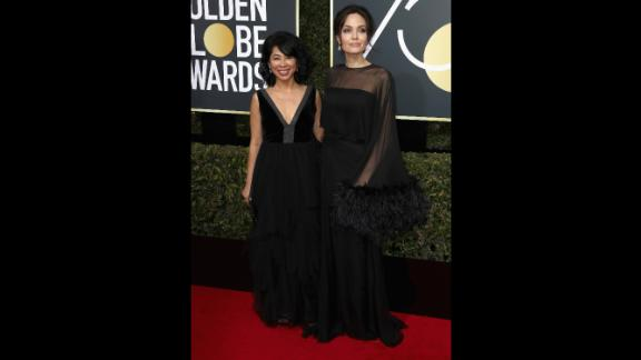 Loung Ung, left, and Angelina Jolie. Ung, a spokeswoman for the Campaign for a Landmine-Free World, was one of several activists who appeared on the red carpet with actors.