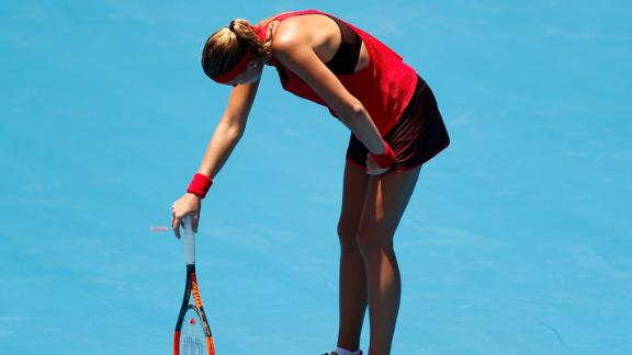 Kristina Mladenovic of France succumbs to the heat playing against Ellen Perez of Australia.