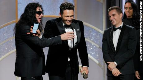 Tommy Wiseau was prevented from speaking by James Franco when the pair were onstage with Dave Franco during the Golden Globes.