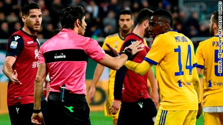 Blaise Matuidi talks with Italian referee Gianpaolo Calvarese after he suffered racist abuse during the Serie A game against Cagliari.