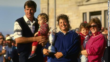 Fanny Sunesson poses with the Claret Jug alongside Nick Faldo and his two children at the 1990 British Open.