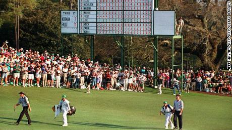 Faldo and Sunesson follow Greg Norman past the leaderboard to the eighteenth green during the final round action at the 1996 Masters.
