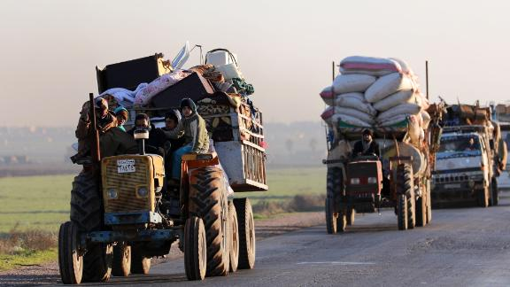 Syrians who fled Idlib province travel along a road in a rebel-held area near Saraqib on Sunday.