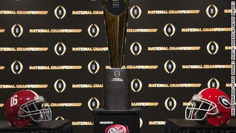 ATLANTA, GA - JANUARY 07:  Detail of the College Football Playoff National Championship trophy, along with the helmets of the 2 competing teams, University of Alabama (left) and University of Georgia (right) on January 7, 2018 in Atlanta, Georgia.  (Photo by Mike Zarrilli/Getty Images)