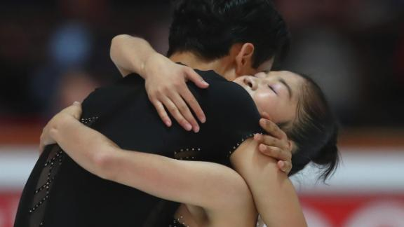 The two North Korean skaters embrace after performing at the pairs free skating during the Nebelhorn Trophy.
