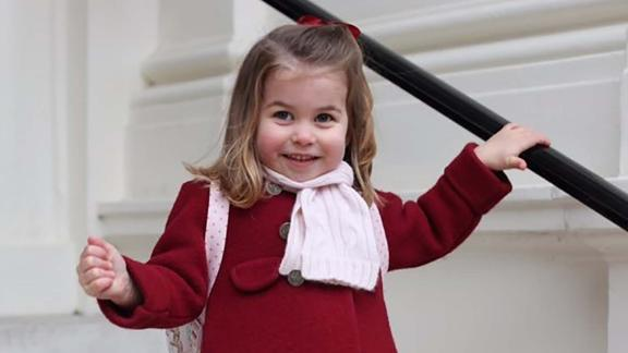 Charlotte smiles in a handout picture provided by the Duke and Duchess of Cambridge as she prepares for her first day at nursery school in January 2018.