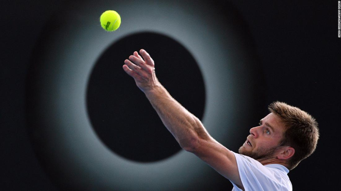 Ryan Harrison serves in front of an advertisement during a second-round match at the Brisbane International on Thursday, January 4. Harrison eventually advanced to the final of the tournament, which was played in Brisbane, Australia.