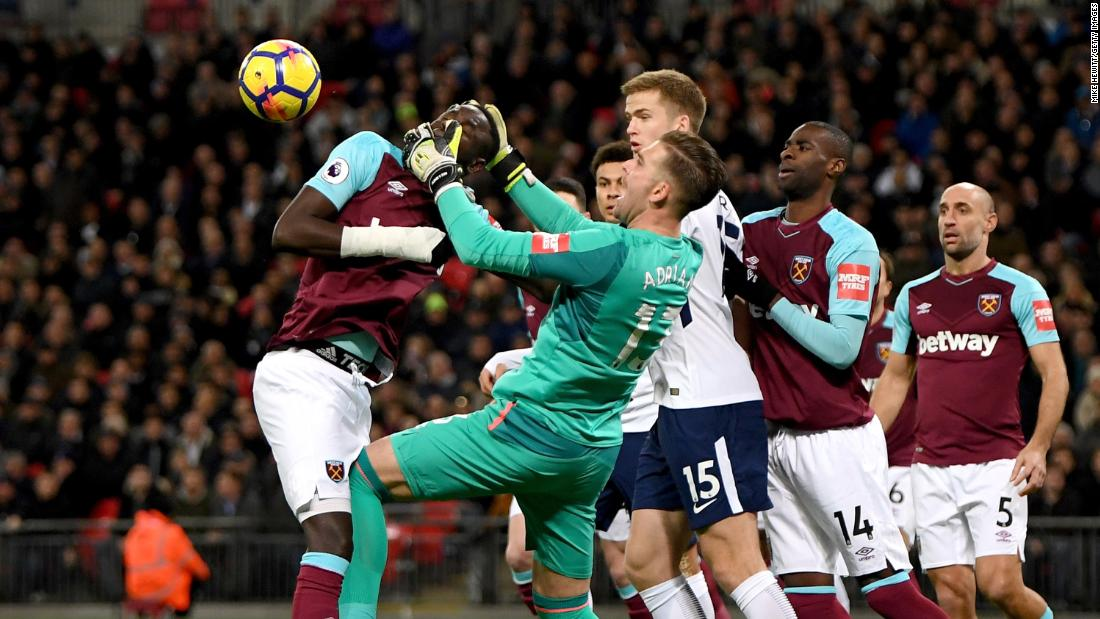 West Ham goalkeeper Adrian gets tangled up with teammate Cheikhou Kouyate during a Premier League match in London on Thursday, January 4.