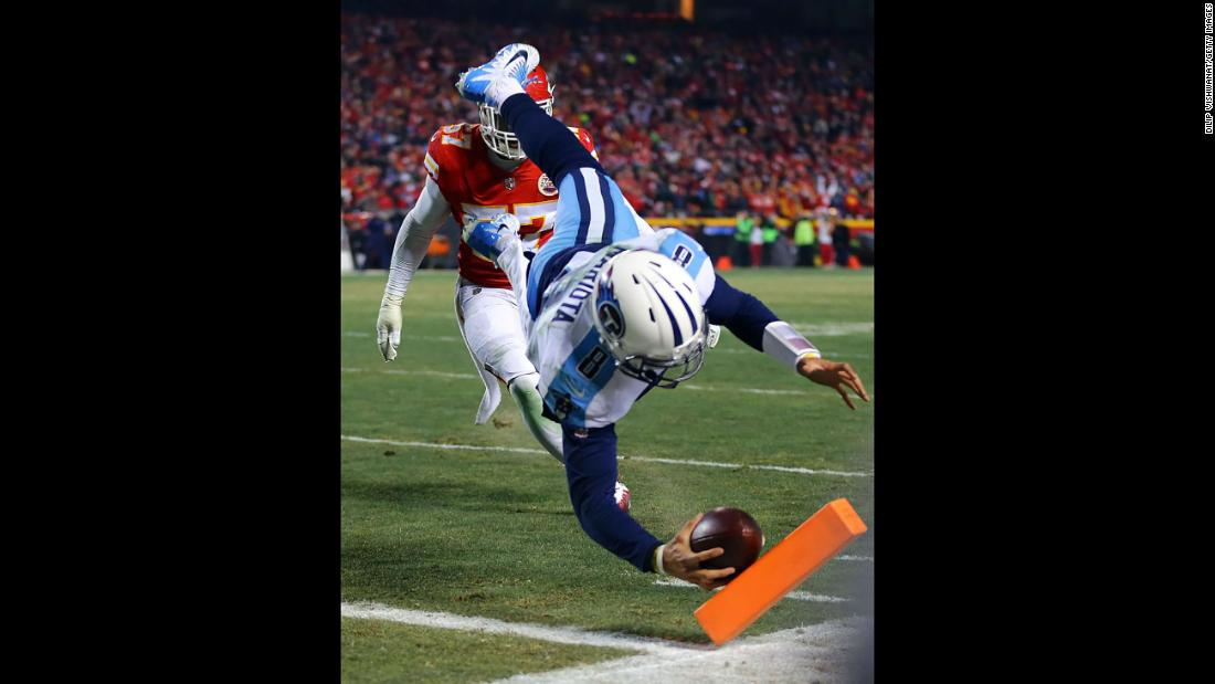 "<a href=""http://bleacherreport.com/articles/2752799-titans-qb-marcus-mariota-completes-td-pass-to-himself-in-afc-wild-card-game"" target=""_blank"">After catching his own deflected pass,</a> Tennessee quarterback Marcus Mariota scores a touchdown in Kansas City, Missouri, on Sunday, January 6. Mariota and the Titans rallied from a 21-3 halftime deficit to defeat the Kansas City Chiefs 22-21 in the wild-card round of the NFL playoffs."