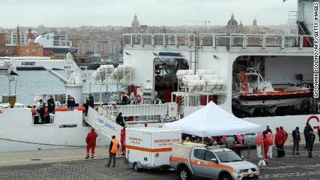 "Rescuers disembark the bodies of migrants on January 8, 2018 after the Italian Coast Guard vessel ""Diciotti"" arrived in the port of Catania following a rescue operation of migrants and refugees at sea. At least 25 people are feared to have drowned in a shipwreck off Libya after a dinghy, possibly carrying some 150 migrants, ran into trouble, two rescue organisations said on January 6, 2018.  The Italian coast guard told AFP 85 people had been rescued from the sinking vessel, and eight bodies recovered so far."