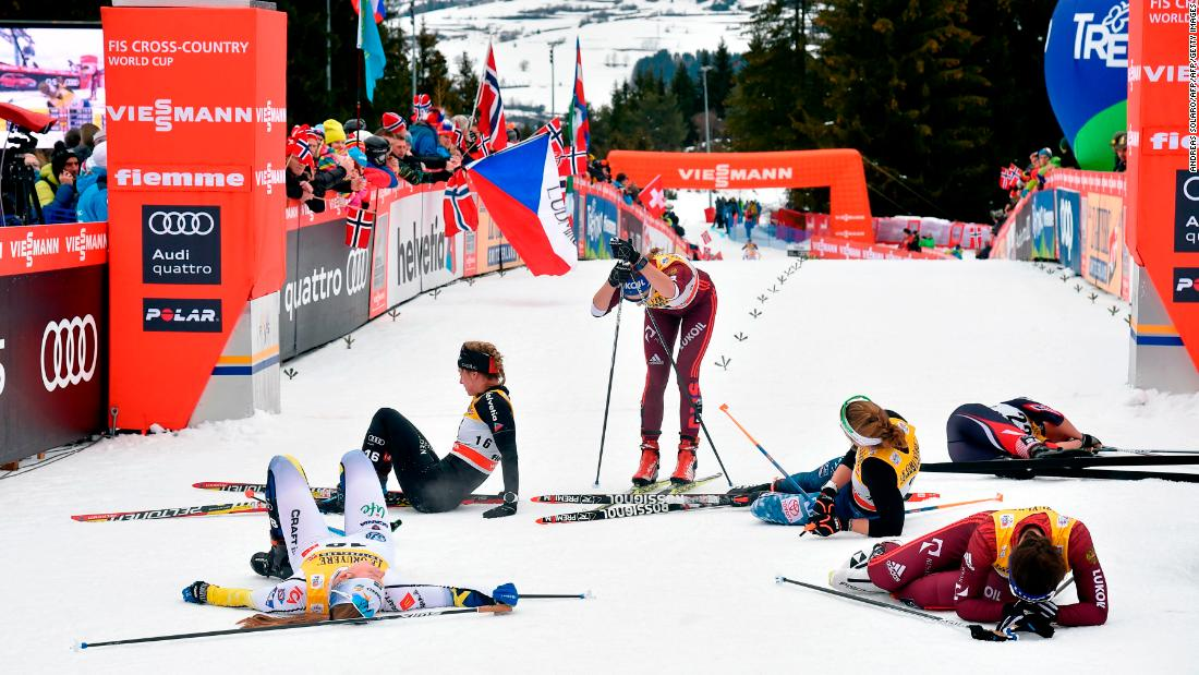Cross-country skiers collapse in exhaustion after a World Cup race in Cavalese, Italy, on Sunday, January 7.