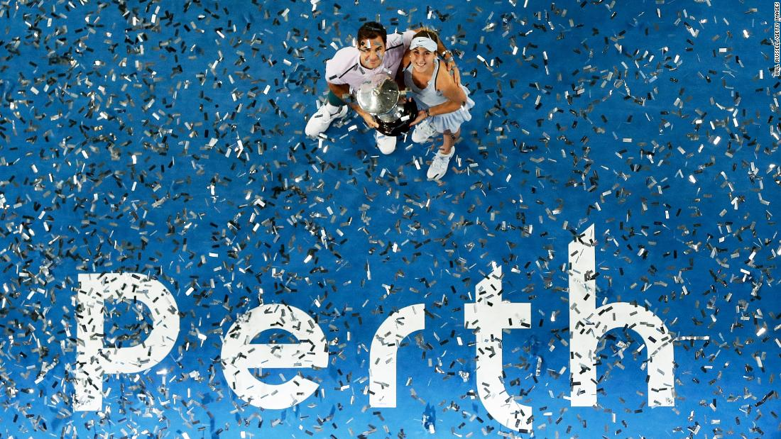 Roger Federer and Belinda Bencic hold the winners trophy after their mixed-doubles victory won the Hopman Cup for Switzerland on Saturday, January 6. The team competition took place in Perth, Australia.