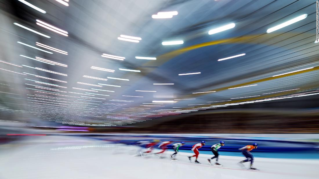 In this photo, taken with a slow shutter speed, athletes compete in the European Speed Skating Championships on Sunday, January 7.