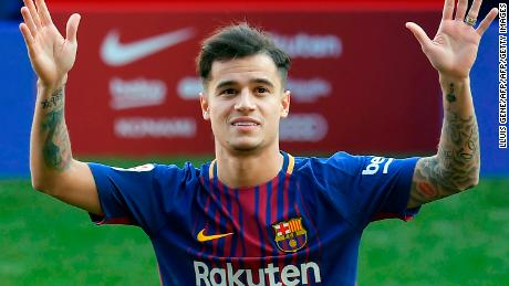 Barcelona's new Brazilian midfielder Philippe Coutinho poses with his new jersey during his official presentation in Barcelona on January 8, 2018.  Philippe Coutinho officially joined Barcelona today, completing a move from Liverpool thought to be worth 160 million euros ($192 million), making it the third richest transfer in history.   / AFP PHOTO / LLUIS GENE        (Photo credit should read LLUIS GENE/AFP/Getty Images)