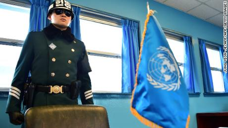 "A South Korean soldier stands guard inside of a UN conference building at the truce village of Panmunjom in the Demilitarized Zone dividing the two Koreas on February 4, 2015. North Korea appeared to rule out any resumption of dialogue with the United States, threatening to react to any US ""war of aggression"" with nuclear strikes and cyber warfare.  AFP PHOTO / JUNG YEON-JE        (Photo credit should read JUNG YEON-JE/AFP/Getty Images)"