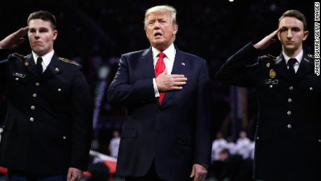 ATLANTA, GA - JANUARY 08:  U.S. President Donald Trump on field during the national anthem prior to the CFP National Championship presented by AT&T between the Georgia Bulldogs and the Alabama Crimson Tide at Mercedes-Benz Stadium on January 8, 2018 in Atlanta, Georgia.  (Photo by Jamie Squire/Getty Images)