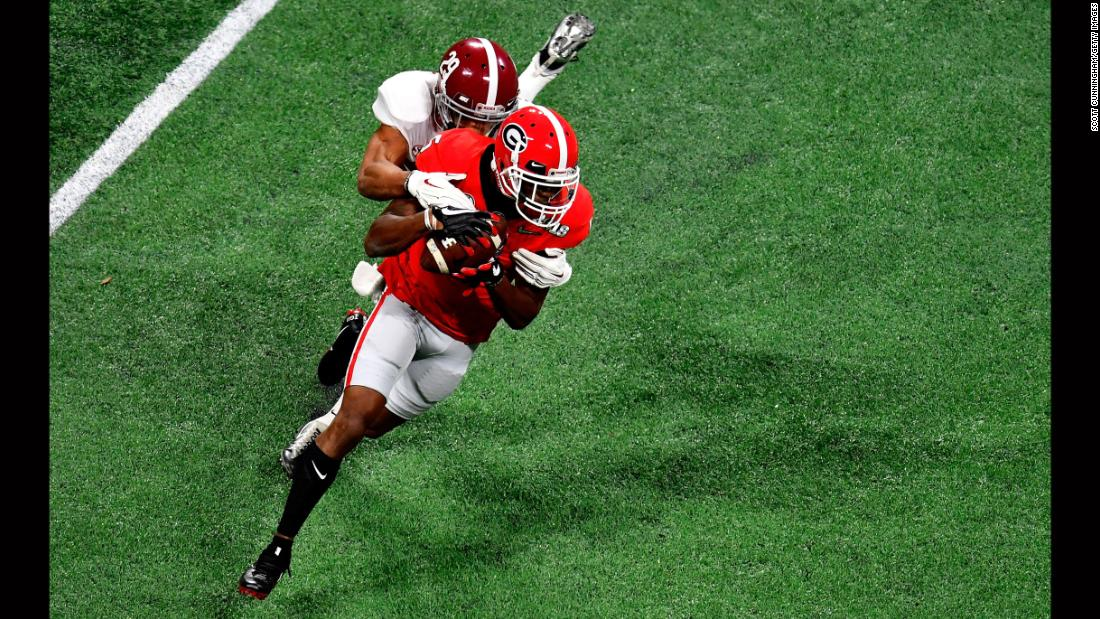 Georgia's Terry Godwin is tackled by Alabama defensive back Minkah Fitzpatrick early in the game.