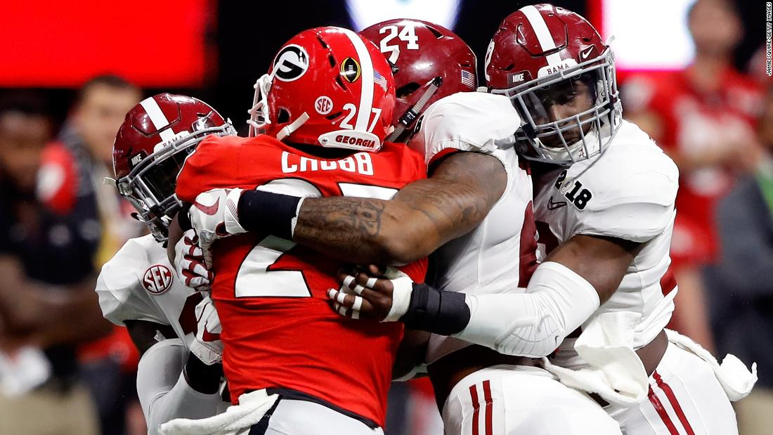 Georgia running back Nick Chubb is tackled by a group of Alabama defenders during the first quarter, which ended scoreless.