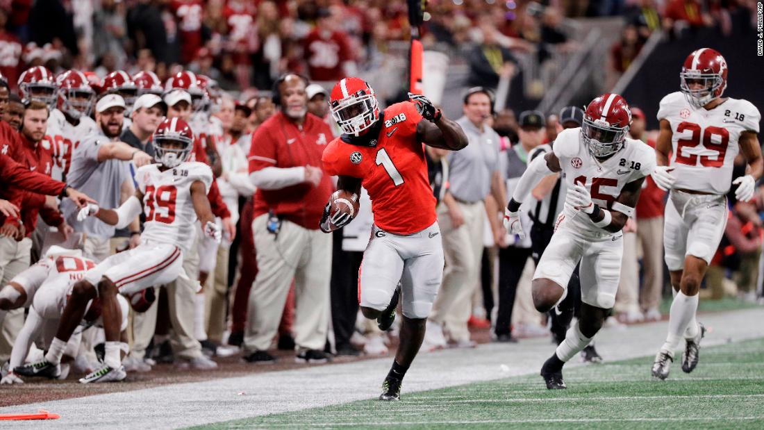 Georgia running back Sony Michel keeps his balance as he runs for a first down on a 3rd-and-20 play. Georgia kicked a field goal on the drive to take a 3-0 lead early in the second quarter.