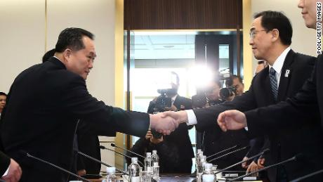 PANMUNJOM, SOUTH KOREA - JANUARY 09:  South Korean Unification Minister Cho Myoung-gyon (R) shakes hands with the head of North Korean delegation Ri Son-Gwon (L) before their meeting at the Panmunjom in the Demilitarized Zone on January 9, 2018 in Panmunjom, South Korea. South and North Korea are scheduled to begin their first official face-to-face talks in two years on Tuesday, January 9, 2017.  (Photo by Korea Pool/Getty Images)
