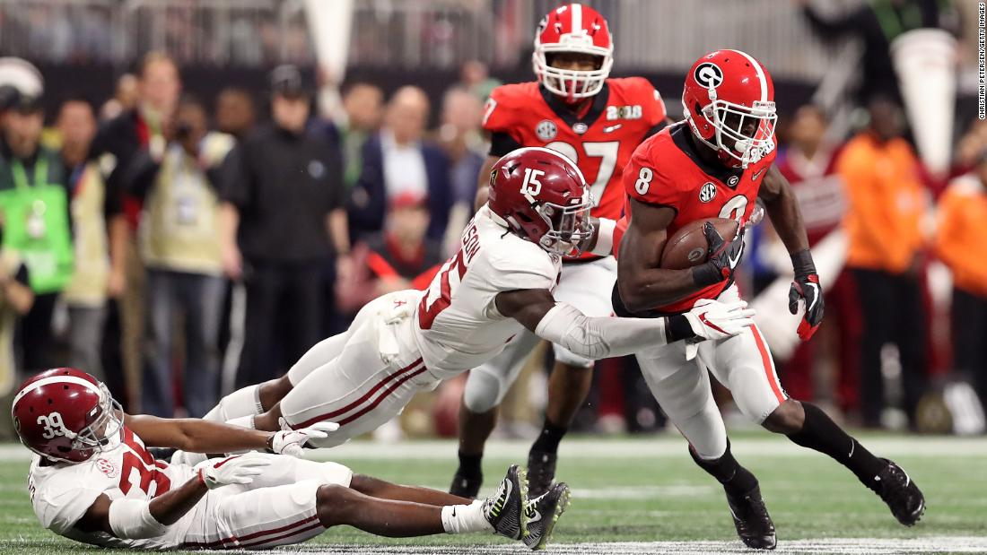 Georgia wide receiver Riley Ridley is tackled in the first quarter by Alabama's Ronnie Harrison. Ridley, whose brother Calvin plays for Alabama, had several first-half catches.