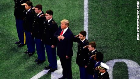U.S. President Donald Trump on field during the national anthem prior to the CFP National Championship presented by AT&T between the Georgia Bulldogs and the Alabama Crimson Tide at Mercedes-Benz Stadium on January 8, 2018 in Atlanta, Georgia.  (Photo by Scott Cunningham/Getty Images)