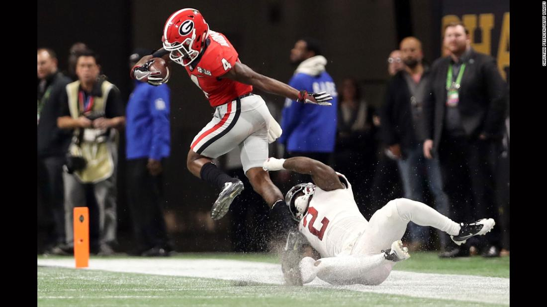 Georgia wide receiver Mecole Hardman eludes an Alabama defender on his way to scoring an 80-yard touchdown in the third quarter. It was Hardman's second touchdown of the game, and it gave Georgia a 20-7 lead.